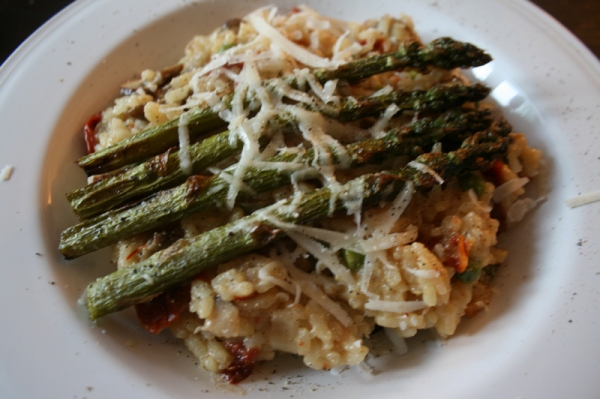Home made risotto topped with roasted asparagus & garlic
