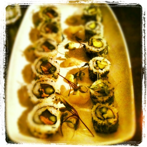 Selection of veggie sushi with wasabi, pickled ginger and soy